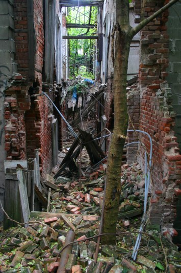 Portions of the roof and walls are just piles of rubble after years of exposure to the elements. (Gordon Donovan)