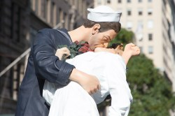 A sculpture of a sailor kissing a woman in a white dress on V-J Day in Times Square rides a float during the Veterans Day parade on Fifth Avenue in New York on Nov. 11, 2014. (Gordon Donovan)