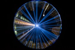 """In a photo taken with a fish eye lens, the two beams of light meet in the art installation """"The Tribute in Light"""" projecting in the night sky over Manhattan on Sept. 11, 2015. (Gordon Donovan)"""