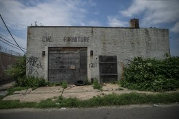 A boarded up furniture store in Camden N.J. (Gordon Donovan)