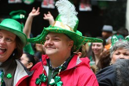 Watchers look festive while watching the St. Patrick's Day Parade, March 17, 2015, in New York. (Gordon Donovan)