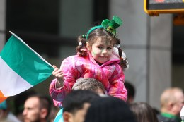 Youngsters dressed in green watch the St. Patrick's Day Parade, March 17, 2015, in New York. (Gordon Donovan)