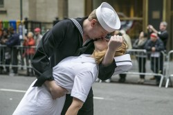 Participants reenact the iconic Alfred Eisenstaedt photograph of a sailor and nurse kissing in Times Square on V-J Day during the Veterans Day Parade in New York City on Nov. 11, 2015. (Gordon Donovan)