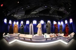 """The characters populating the Galactic Senate, the galaxy's republican governing body, represent the wide spectrum of planets and cultures that make up the """"Star Wars"""" universe. Using costumes, masks, props, make up, and other visual details, the costuming department worked closely with the art department and set designers to invent representatives of these many worlds. They worked together to create a fantasy universe of characters that appear timeless, yet still evoke a singular identity for the many different cultures they represent. (Gordon Donovan/Yahoo News)"""