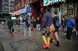 Bystanders take photos as participants of the No Pants Subway Ride take it to the streets as they head towards Union Square in New York City, Sunday, Jan. 10, 2016. (Gordon Donovan/Yahoo News)