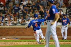New York Mets Wilmer Flores (4) scores in the second inning of a baseball game against the Boston Red Sox at Citi Field in New York, Friday, Aug. 28, 2015. (Gordon Donovan)
