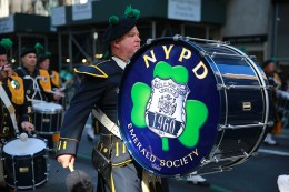 A member of the NYPD Emerald Society performs on Fifth Ave. during the St. Patrick's Day Parade, March 17, 2016, in New York. (Gordon Donovan/Yahoo News)
