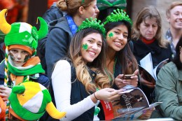 Two young woman proudly wear shamrocks on their cheeks enjoy the St. Patrick's Day Parade on March 17, 2016, in New York. (Gordon Donovan/Yahoo News)
