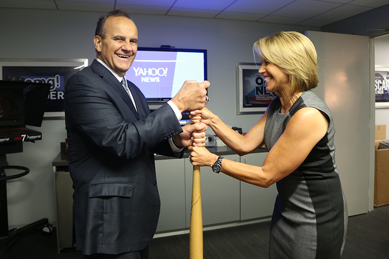 Katie Couric takes on Hall of Fame Yankees Manager Joe Torre to choose sides with an official Yahoo bat at the Yahoo News Studios in New York City, Thursday, Sept. 25, 2014. (Yahoo News/Gordon Donovan)
