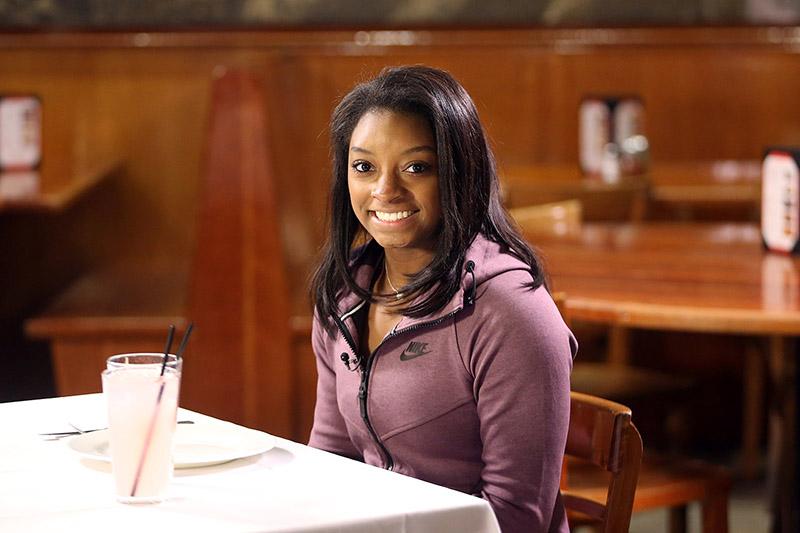 Olympic gold medalist Simone Biles before an interview at John's Pizzeria in New York City on Nov. 18, 2016. (Gordon Donovan/Yahoo News)