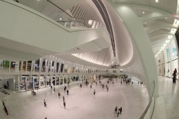 People walk through the Oculus mall at World Trade Center on Wednesday, August 17, 2016. It stretches along a four-block underground network that spans the bases of three office towers. While mostly below street level, light beams in through the windows of the winged Oculus, designed by Santiago Calatrava, that top the transportation hub of 13 subway trains and river ferries. (Gordon Donovan/Yahoo News)
