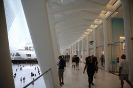 People walk through the Oculus mall at World Trade Center on Monday, August 22, 2016. (Gordon Donovan/Yahoo News)