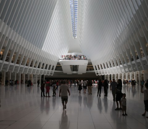 People walk through the Oculus mall at World Trade Center on Monday, August 22, 2016.(Gordon Donovan/Yahoo News)