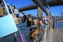 A view of love padlocks attached on the railings of Pier 1 next to the Brooklyn Bridge on August 23, 2016. (Gordon Donovan/Yahoo News)