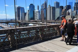 Love padlocks attached to light posts and fences on the Brooklyn Bridge on August 23, 2016. (Gordon Donovan/Yahoo News)