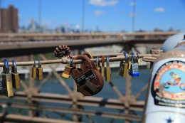 An older style lock hangs on a light post on the Brooklyn Bridge on August 23, 2016. (Gordon Donovan/Yahoo News)