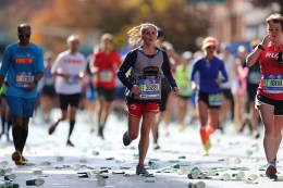 A participant trudges up First Ave. approaching mile 17 of the 2016 New York City Marathon, Nov. 6, 2016. (Gordon Donovan/Yahoo News)