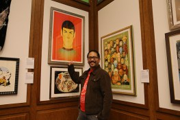 """Stanley Chow gestures towards his work """"Teleportation of Mr. Spock."""" Chow is an illustrator, artist and graphic designer who hails fom the North of England. He is known for his portraits, particulary of pop-culture figures, and his clients include Saatchi and Saatchi and McDonald's. (Photo: Gordon Donovan/Yahoo News)"""