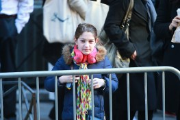 A youngster stands on the sidewalk outside at a polling site in New York City as lines to vote were held up while Republican presidential candidate Donald Trump voted inside on Tuesday, Nov. 8, 2016. (Gordon Donovan/Yahoo News)