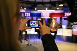 A staffer takes a photo of the Yahoo News election panel at the Yahoo News Studios on Tuesday, Nov. 8, 2016. (Gordon Donovan/Yahoo News)