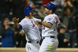 New York Mets Neil Walker (20) is congratulated after homering in the eighth inning of a baseball game against the Cincinnati Reds at Citi Field in New York, Monday, April 25, 2016. (Gordon Donovan)