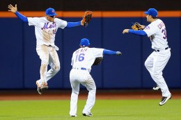 New York Mets outfielders Juan Lagares (12), Alejandro De Aza (16) and Michael Conforto (30) celebrate the Mets 5-2 win against the Cincinnati Reds at Citi Field in New York, Wednesday, April 27, 2016. (Gordon Donovan)