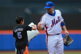 New York Mets 3B David Wright (5) fist bumps a young fan in the seventh inning of a baseball game against the Milwaukee Brewers at Citi Field in New York, Sunday, May 22, 2016. (Gordon Donovan)