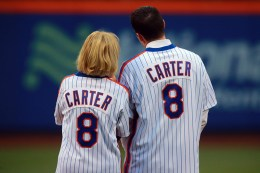 The wife and son of former 1986 New York Mets catcher Gary Carter stand on the field during a ceremony honoring the 1986 World Champions at Citi Field in New York, Saturday, May 28, 2016. (Gordon Donovan)