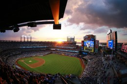 In a photo taken with a fisheye lens, the sun begins to set during the fourth inning of a baseball game against the Kansas City Royals and New York Mets from the right field corner on the promenade level at Citi Field in New York, Tuesday, June 21, 2016. (Gordon Donovan)