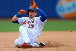 New York Mets Asdrubal Cabrera (13) slides into 3B in the sixth inning of a baseball game against the Miami Marlins at Citi Field in New York, Monday, July 4, 2016. (Gordon Donovan)