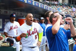 New York Mets Yoenis Cespedes yells as Mets staff cheer on a young fan setting a whiffle ball home run record on Citi Vision in the fourth inning of a baseball game against the Miami Marlins at Citi Field in New York, Monday, July 4, 2016. (Gordon Donovan)