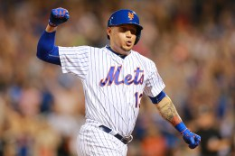 New York Mets Asdrúbal Cabrera (13) pumps his fists in the air as he rounds 3rd base following Wilmer Flores' three-run homer in the fifth inning of a baseball game against the Washington Nationals at Citi Field in New York, Thursday, July 7, 2016. (Gordon Donovan)