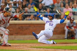 New York Mets Yoenis Cespedes (52) beats the throw into home plate to score in the third inning of a baseball game against the Washington Nationals at Citi Field in New York, Thursday, July 7, 2016. (Gordon Donovan)