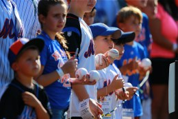 New York Mets fans look for autographs before the baseball game against the Arizona Diamondbacks at Citi Field in New York, Tuesday, Aug. 9, 2016. (Gordon Donovan)