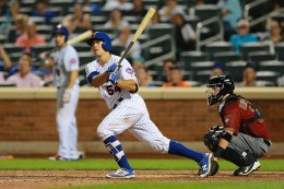 New York Mets T.J. Rivera (54) singles for his first big league hit in the tenth inning of a baseball game against the Arizona Diamondbacks at Citi Field in New York, Wednesday, Aug. 10, 2016. (Gordon Donovan)