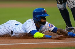 New York Mets Jose Reyes (7) slides head first into 3B in the first inning of a baseball game against the San Diego Padres at Citi Field in New York, Saturday, Aug. 13, 2016. (Gordon Donovan)