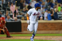 New York Mets Yoenis Cespedes (52) flips his bat in the air after blasting a three run homer in the fourth inning of a baseball game against the Philadelphia Phillies at Citi Field in New York, Saturday, Aug. 27, 2016. (Gordon Donovan)