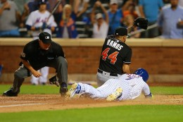 New York Mets Jose Reyes (7) scores as he collides with Miami Marlins relief pitcher A.J. Ramos (44) on a wild pitch in the eighth inning of a baseball game at Citi Field in New York, Monday, August 29, 2016. (Gordon Donovan)