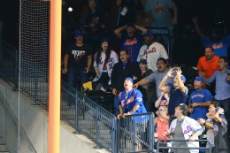 New York Met fans react as Lucas Duda's deep drive to right field hooks foul in the tenth inning of a baseball game against the Philadelphia Phillies at Citi Field in New York, Thursday, Sept. 22, 2016. (Gordon Donovan)