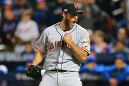 San Francisco Giants Madison Bumgarner (40) pumps his fist after the final out of the National League wild-card baseball game against the New York Mets at Citi Field in New York, Wednesday, October 5, 2016. Bumgarner pitched a complete-game shutout to beat the Mets 3-0. (Gordon Donovan)