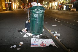 Discarded sign lies near a trash can from the Women's March in New York City on Jan. 21, 2017. (Gordon Donovan/Yahoo News)