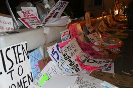 Discarded signs from Women's March lie on streets around the corner from Trump Tower in New York City on Jan. 21, 2017. (Gordon Donovan/Yahoo News)
