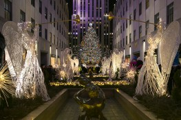Angels hold up trumpets in the Garden at Rockefeller Center. (Gordon Donovan/Yahoo News)