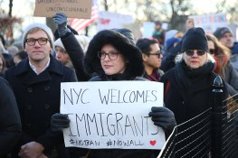 Protesters and immigrants' rights' advocates rally in opposition to President Donald Trump's immigration order as it sowed more chaos and outrage across the country, Jan. 29, 2017, at Battery Park in New York. (Gordon Donovan/Yahoo News)