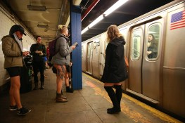 Passengers wait for the subway as they take part in the No Pants Subway Ride in New York City, Sunday, Jan. 8, 2017. The No Pants Subway Ride began in 2002 in New York as a stunt and has taken place in cities around the world since then. (Gordon Donovan/Yahoo News)
