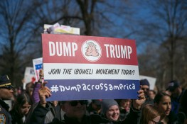 "A demonstrator holds up a ""Dump Trump"" sign during the ""Not My President's Day"" rally on Central Park West in New York City on Feb. 20, 2017. (Gordon Donovan/Yahoo News)"
