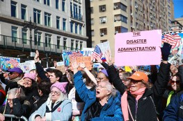 """Demonstrators hold up signs and chant anti-Trump slogans at the """"Not My President's Day"""" rally at Central Park West in New York City on Feb. 20, 2017. (Gordon Donovan/Yahoo News)"""