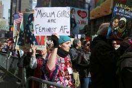 "A young woman holds up a sign showing support at the ""I am a Muslim too"" rally at Times Square in New York City on Feb. 19, 2017. (Gordon Donovan/Yahoo News)"