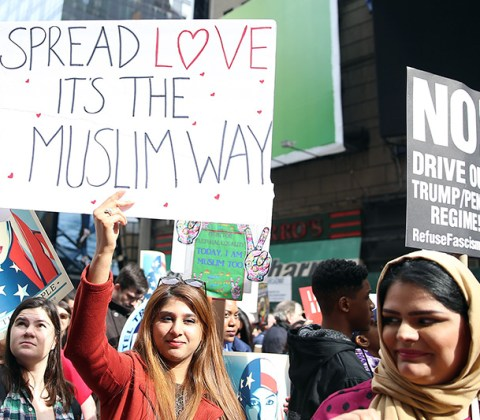 "Several young women demonstrate holding up signs during the ""I am a Muslim too"" rally in Times Square, New York City on Feb. 19, 2017. (Gordon Donovan/Yahoo News)"