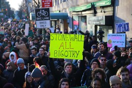 People protest in front of the Stonewall Inn in solidarity with immigrants, asylum seekers, refugees, and the LGBT community, Feb. 4, 2017 in New York. (Photo: Gordon Donovan/Yahoo News)